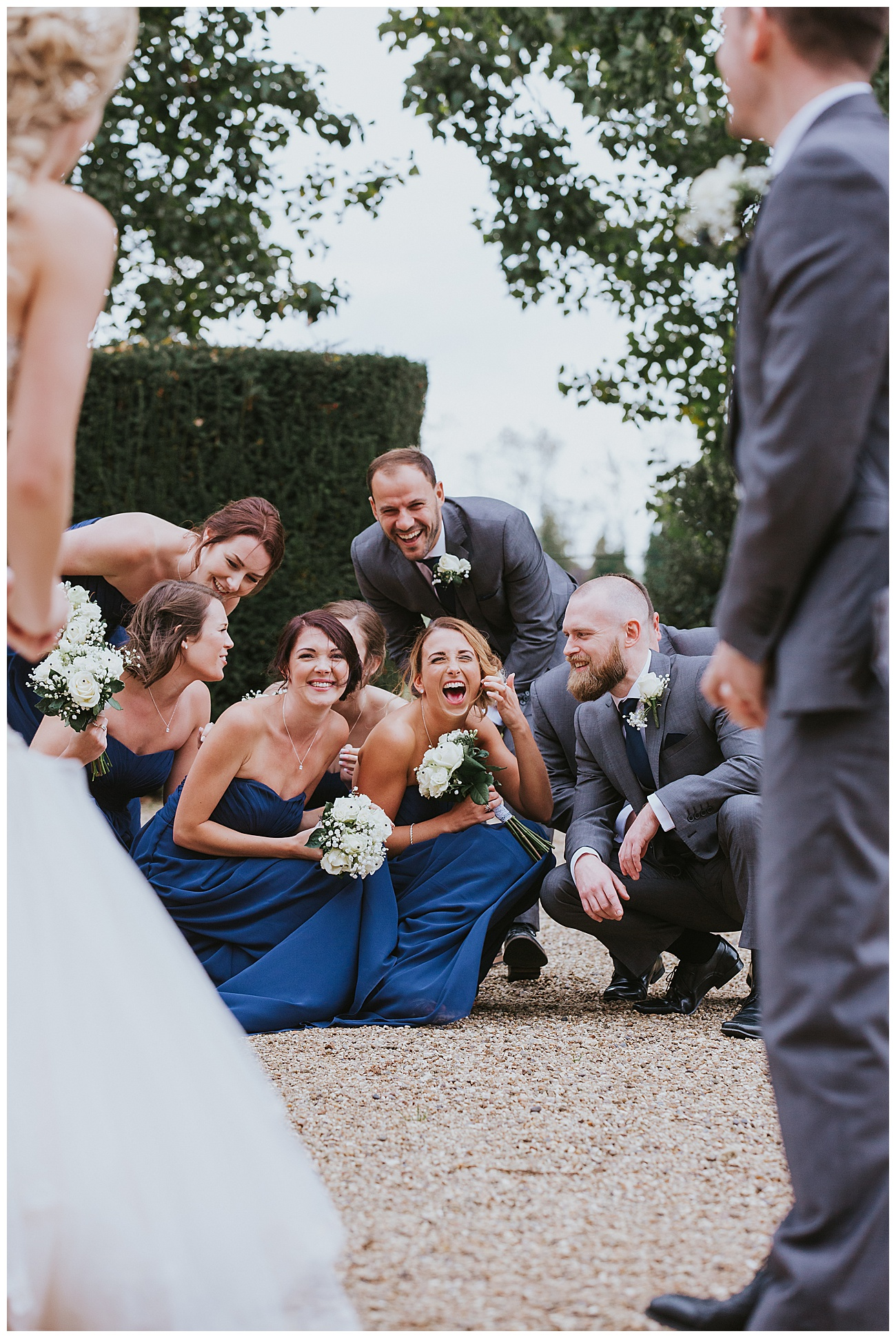 bridal party laugh at a joke together outside