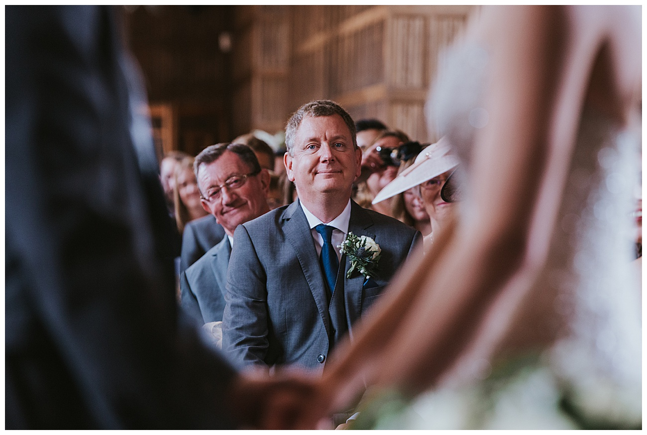 Proud dad looks at the couple during the ceremony
