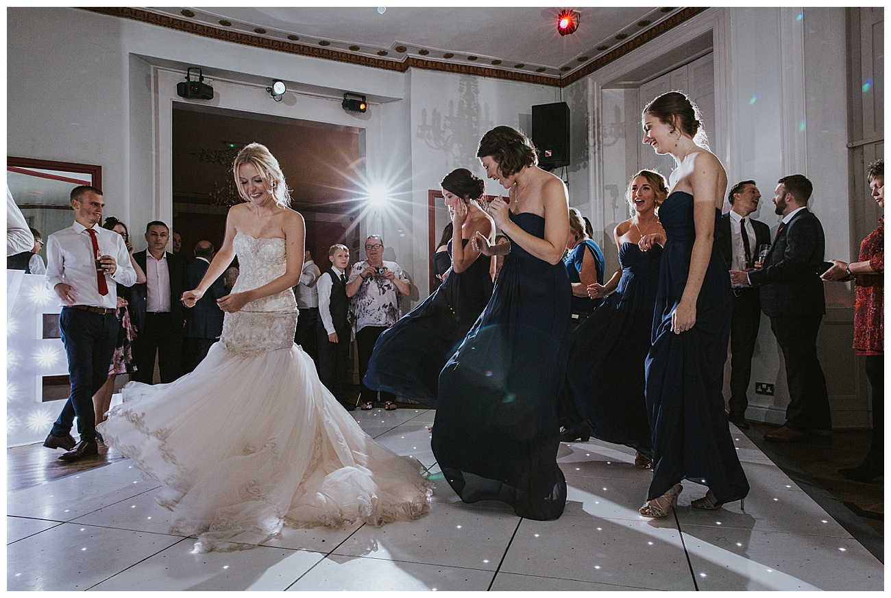 Bridal party dance to a song