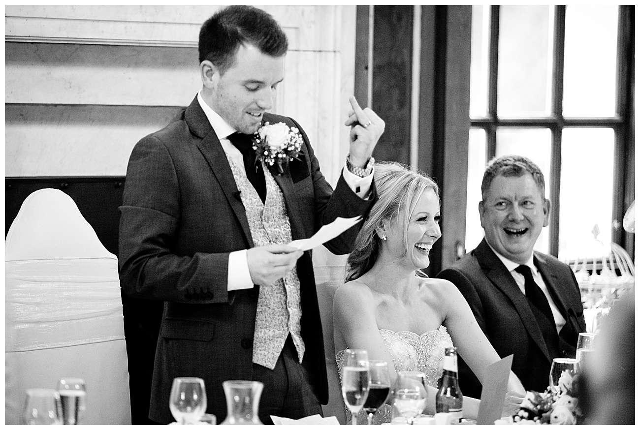 The groom cracks a joke during his speech