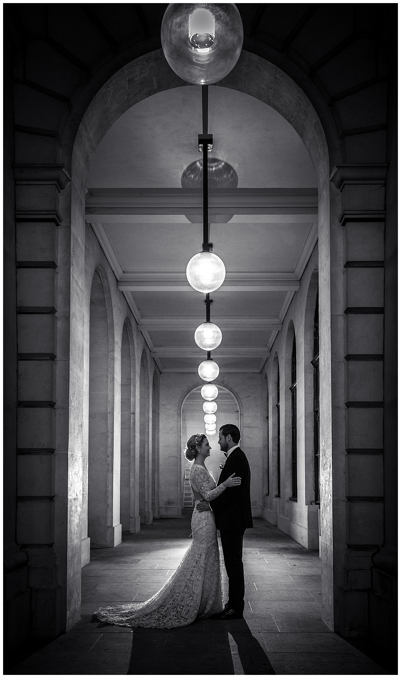 Bride and groom hold each other outside in the grounds of Gibson Hall