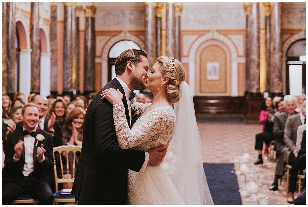 The bride and groom share a kiss as they become husband and wife