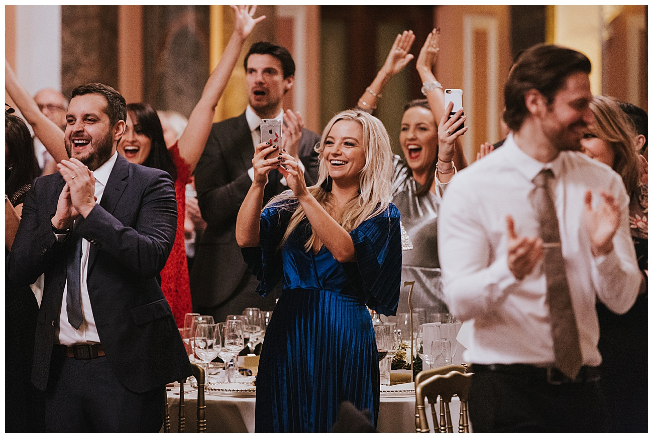 A standing ovation from the wedding guests as the couple enter the reception room