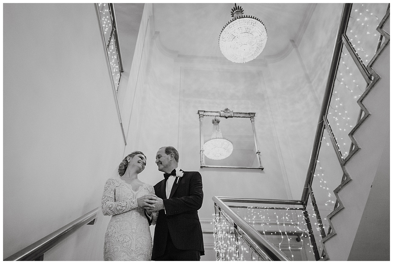 Bride and her dad laugh on the stairs at Gibson Hall before entering the ceremony room