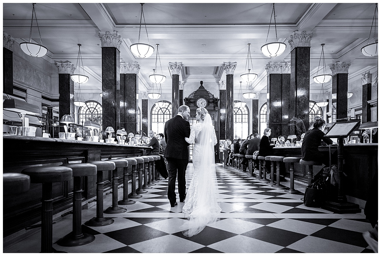 The bride and her dad walk through the bar at the Ned and look at each other before heading for the exit