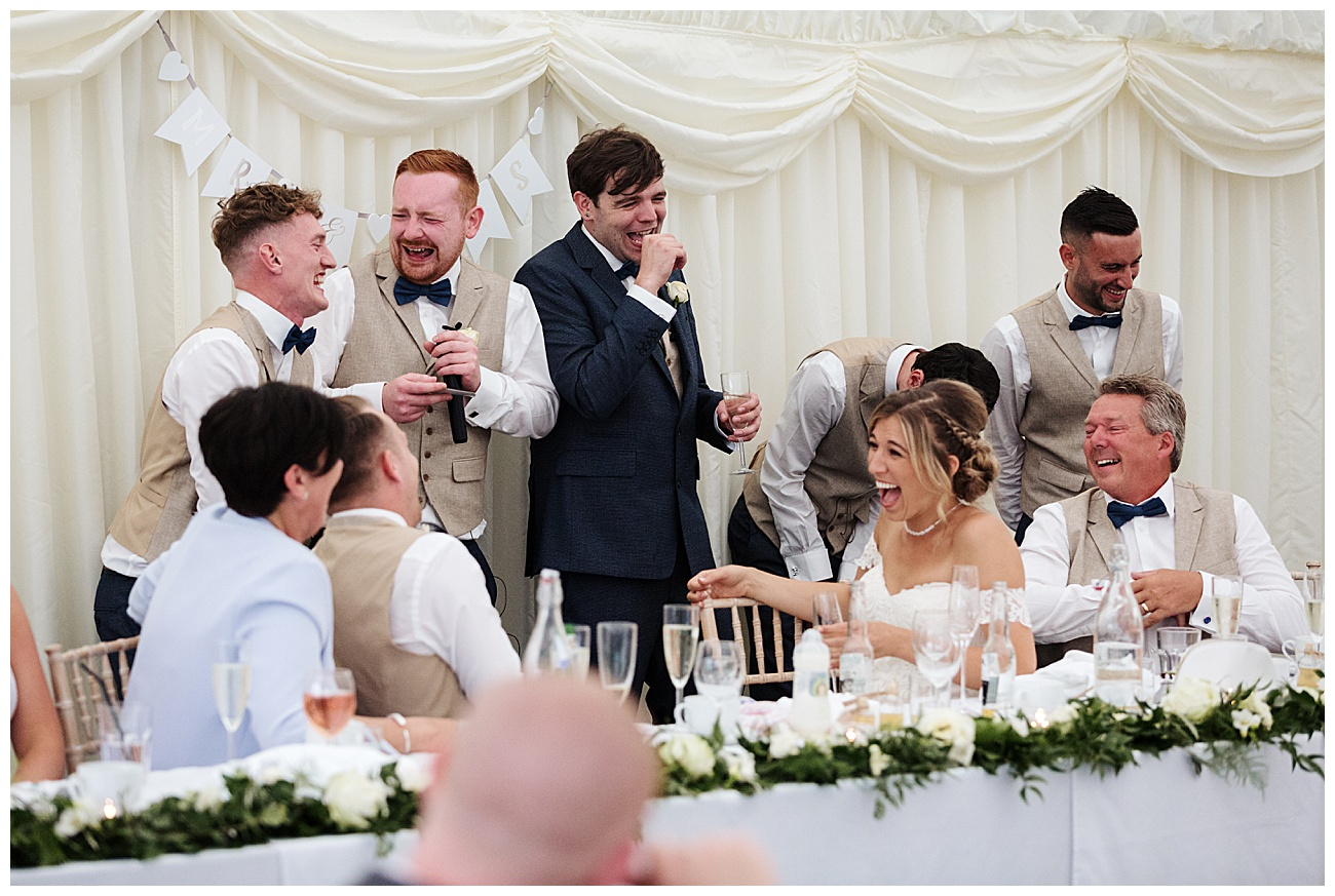 The top table share a joke during the speeches