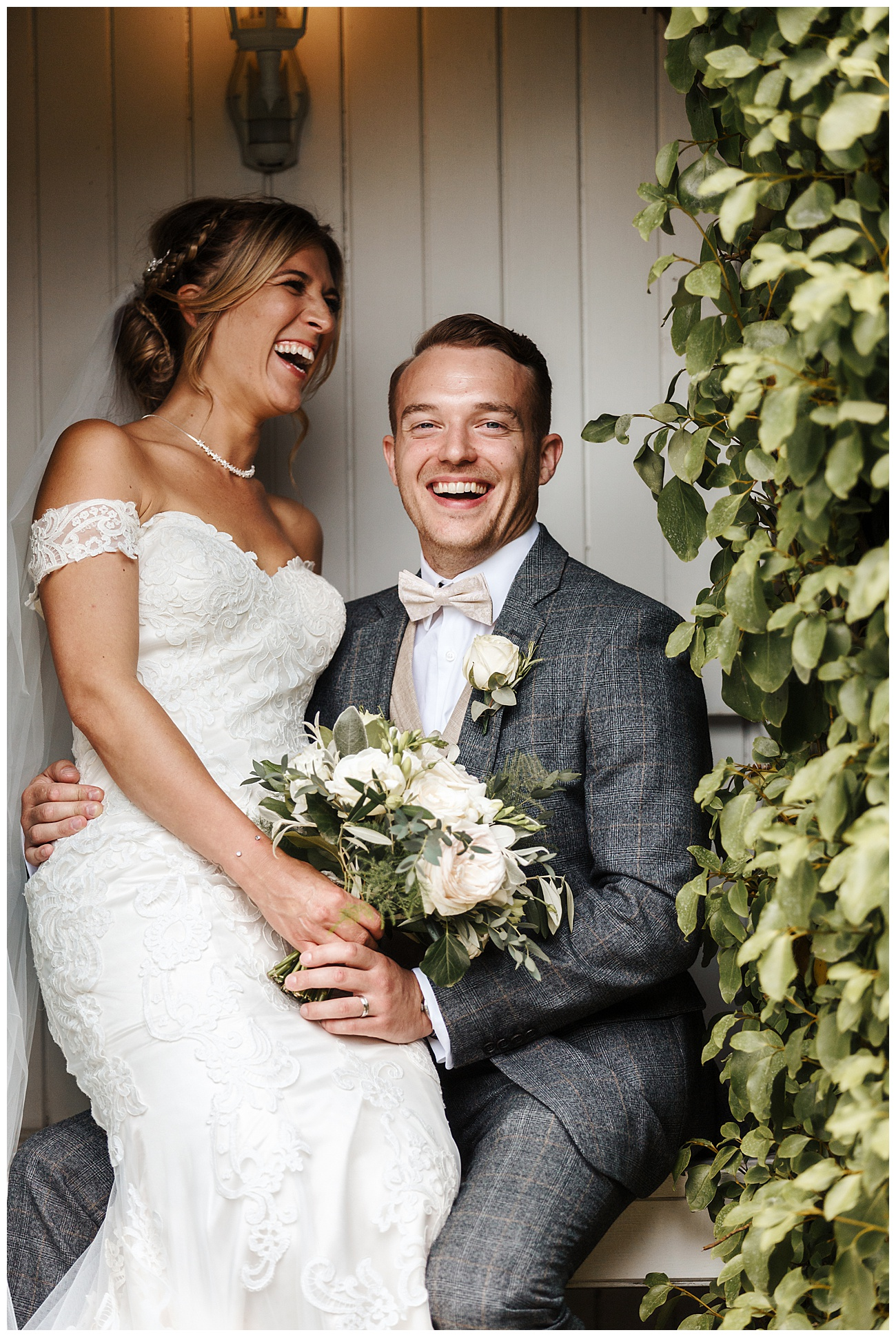The bride and groom share a joke in the gardens