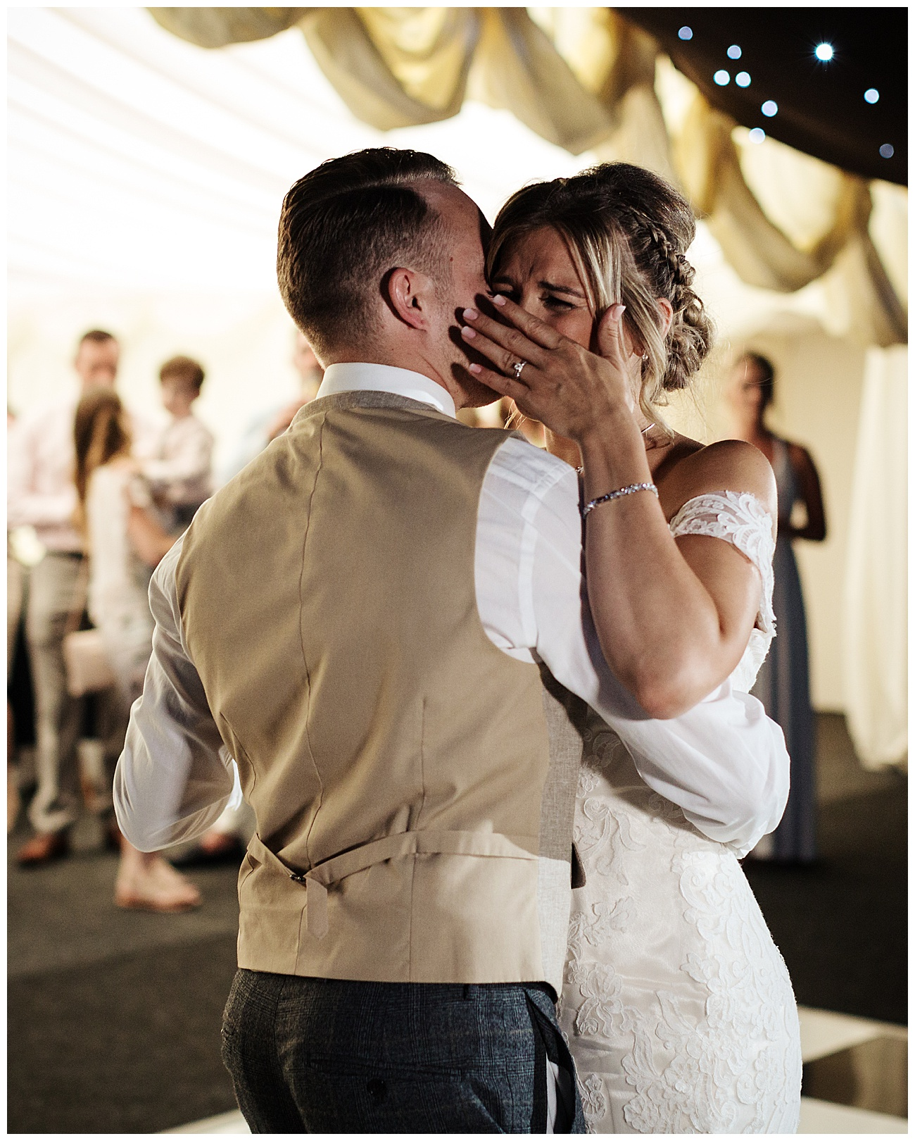 The bride gets emotional during their first dance