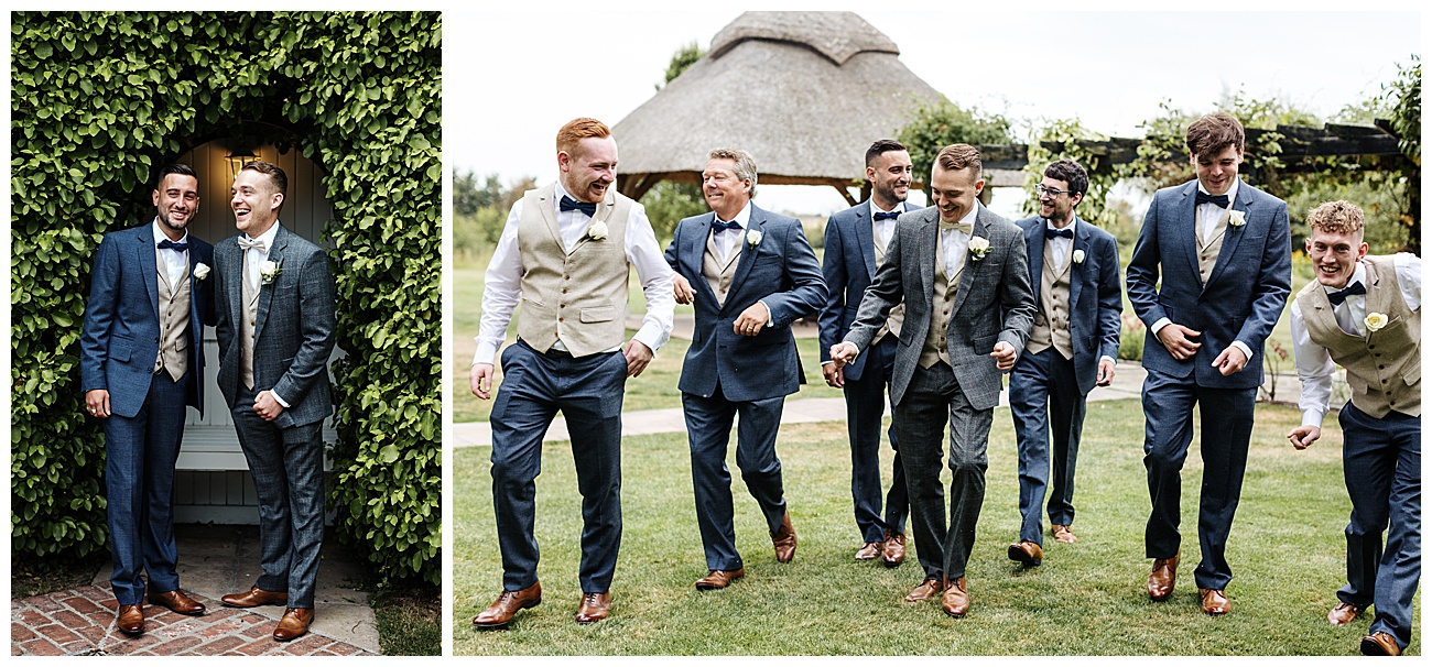 The groomsmen share a joke and walk in their wedding suits