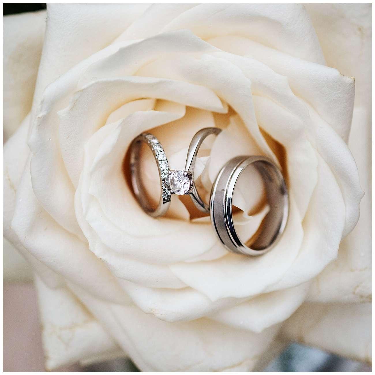 The wedding rings inside a white flower