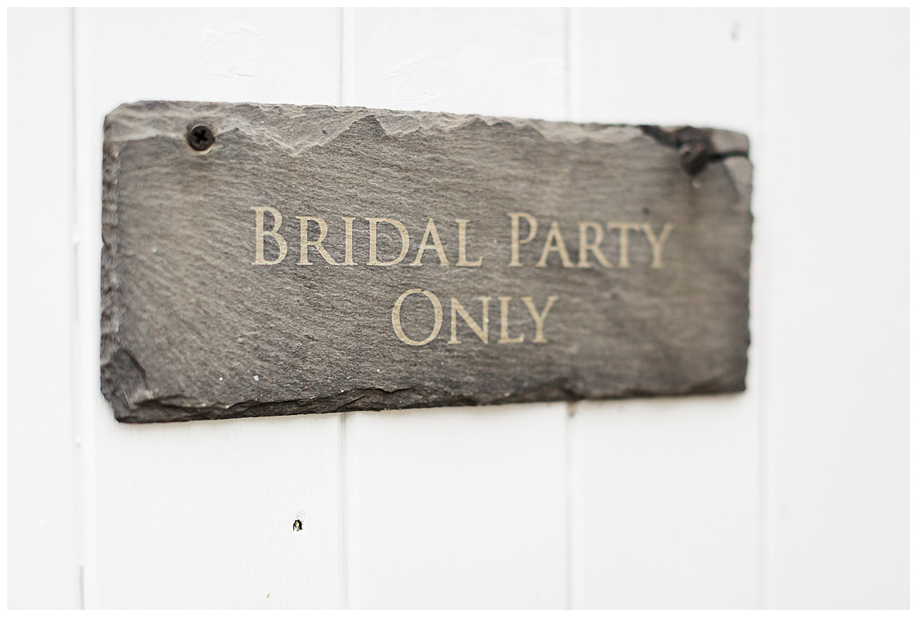 The bridal cottage sign on the wooden door