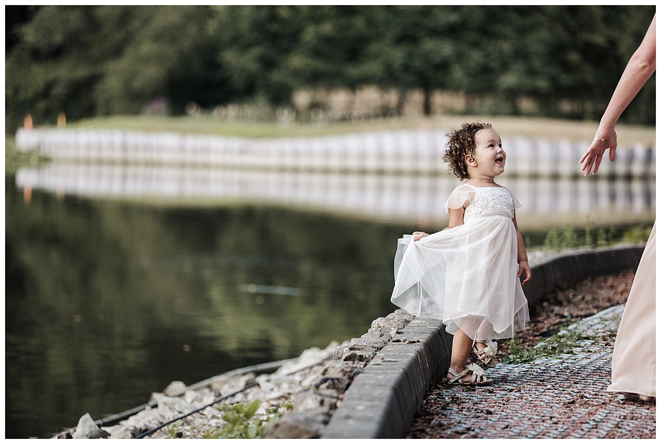 Flower girl laughs by the lake
