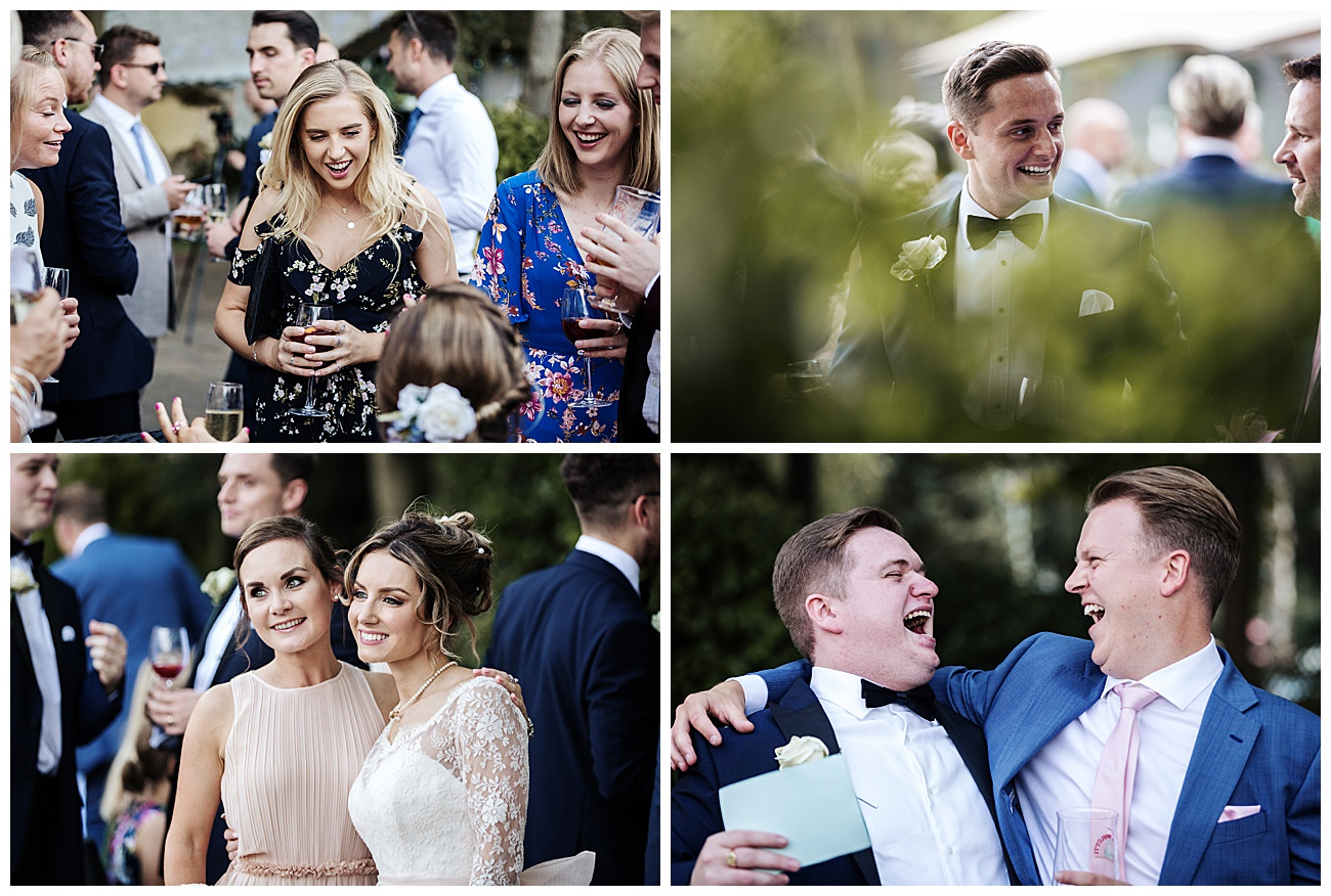wedding guests laughing and joking having drinks