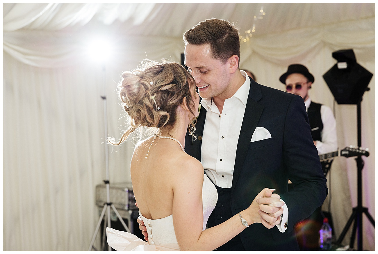 Bride and groom dance to the music of their first dance