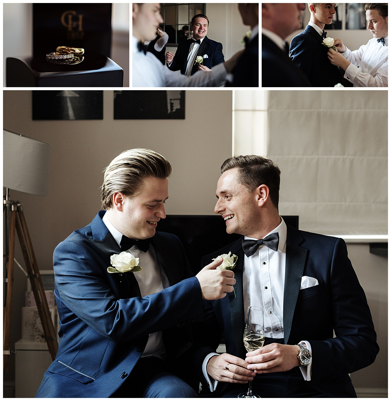 Groom laughs with groomsmen as they add the buttonholes to their wedding suits