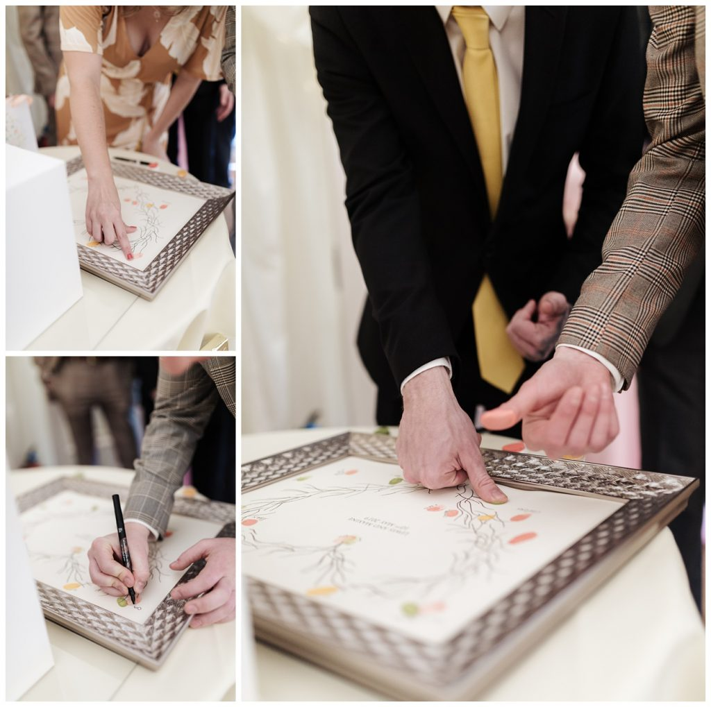 Finger prints are added to a memory tree by the wedding guests as a gift to the couple