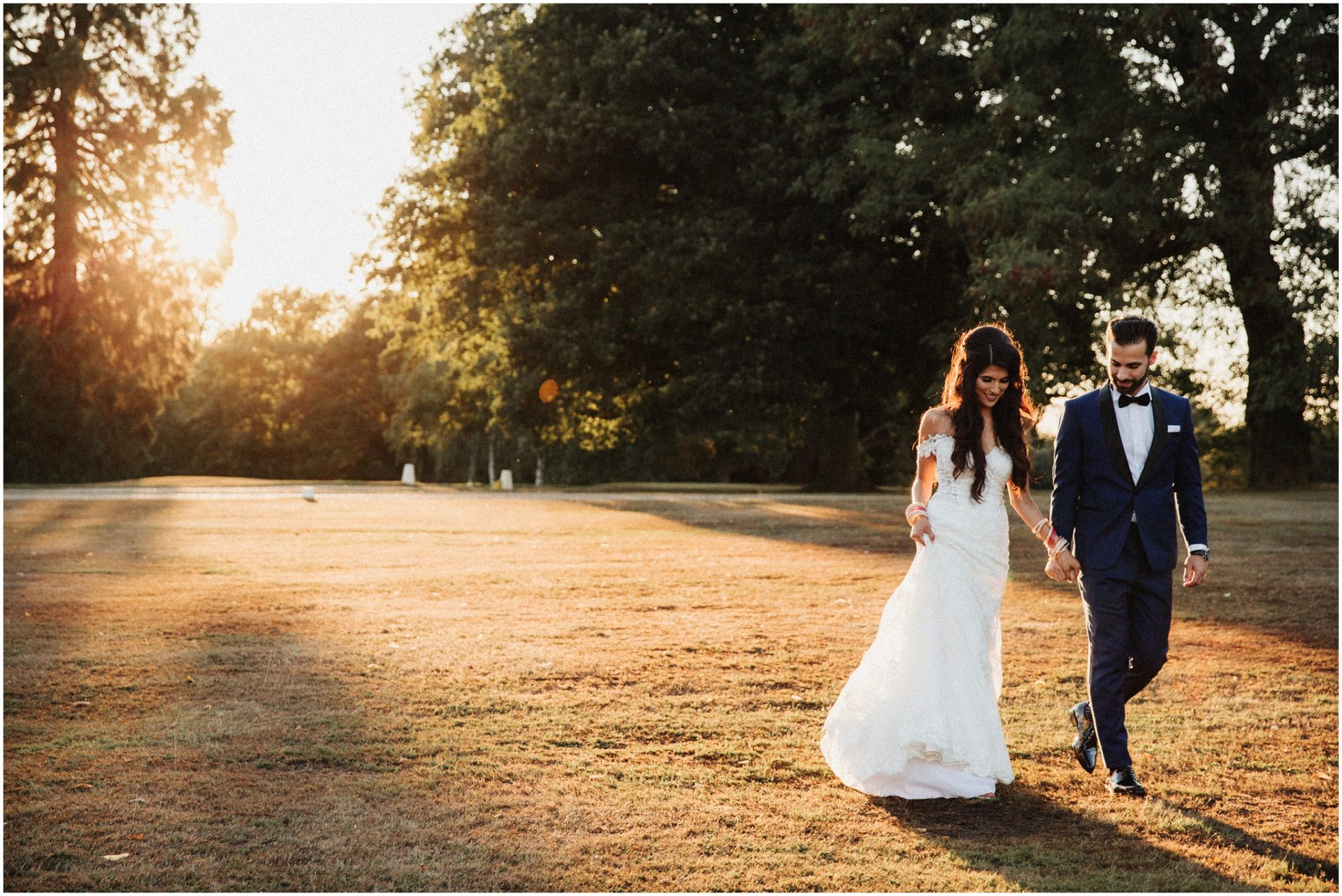 Summer-image-of-a-bride-and-groom-in-the-fields-at-Braxted-Park