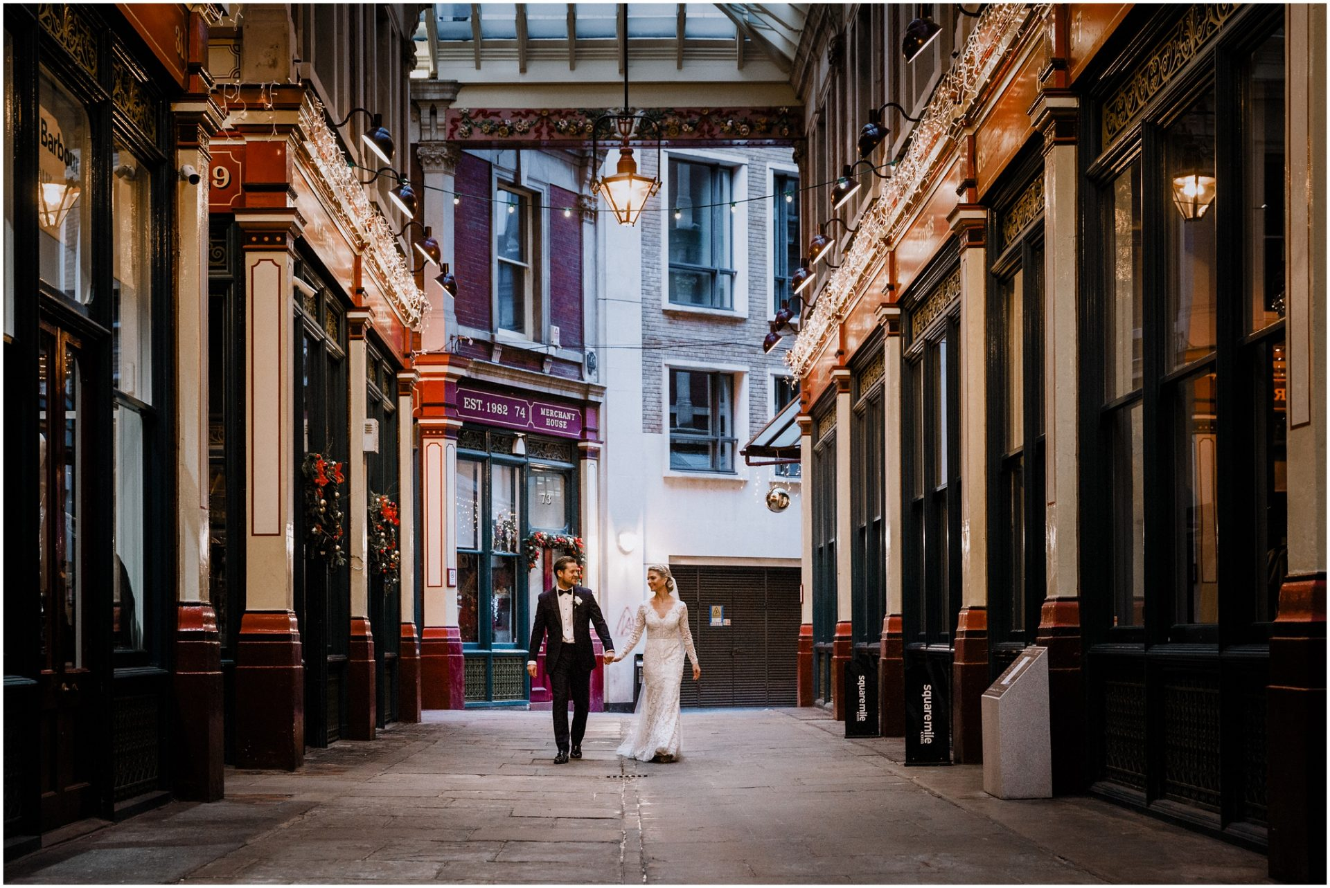 Bride-and-groom-walk-through-Leadenhall-market-holding-hands