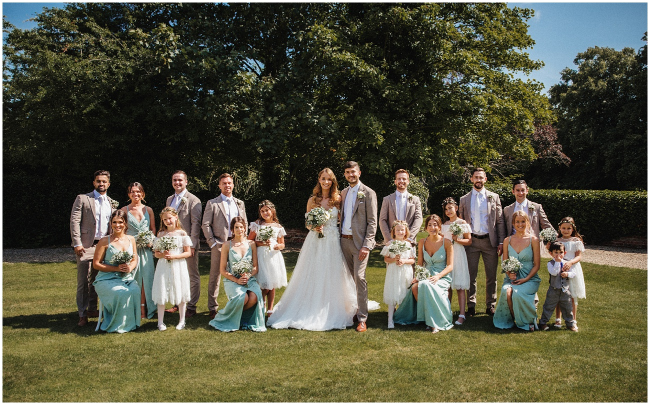 A group shot of the bride and groom and their bridal party