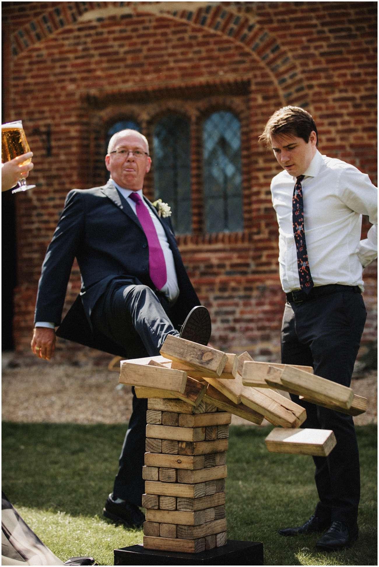 Wedding guest kicks over a Jenga tower