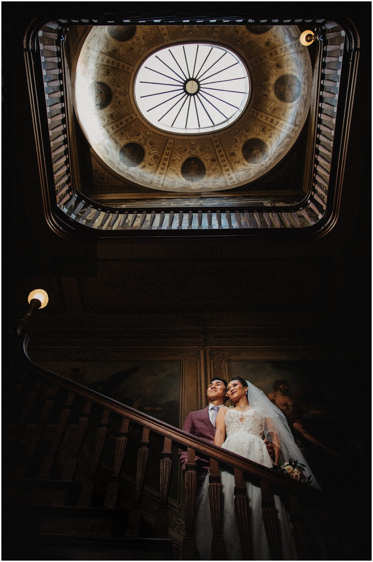 Bride-and-groom-pose-on-the-stair-case-at-Moor-Park-Wedding-Venue