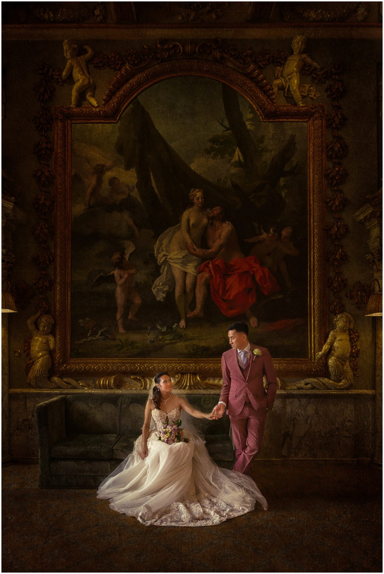 Bride-and-groom-hold-hands-inside-a-room-at-Moor-Park-wedding-venue-in-Hertfordshire