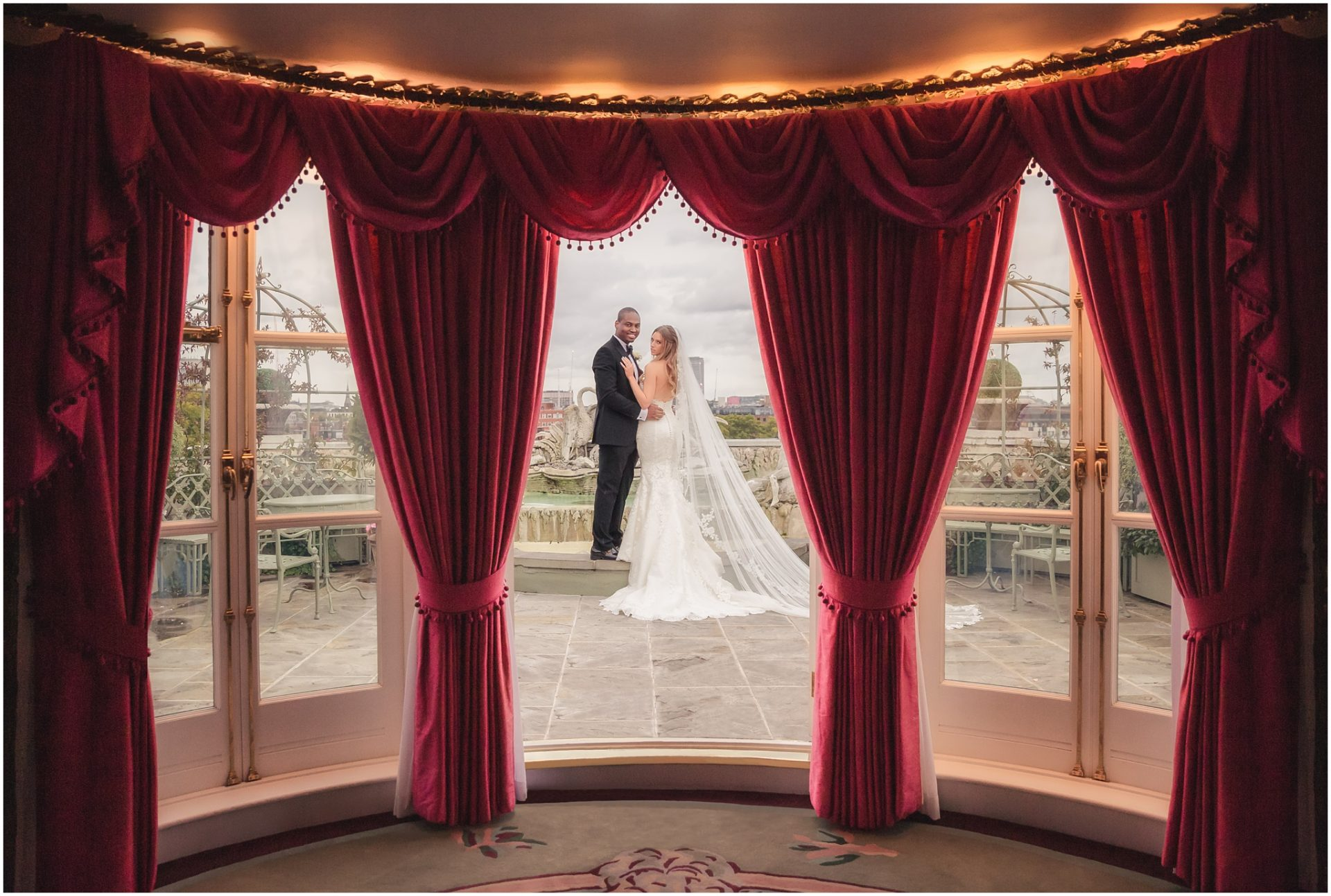 Bride-and-groom-pose-in-the-Oliver-Messel-Suite-at-the-Dorchester-London