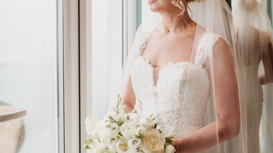 A portrait of the bride in her wedding dress holding her flowers