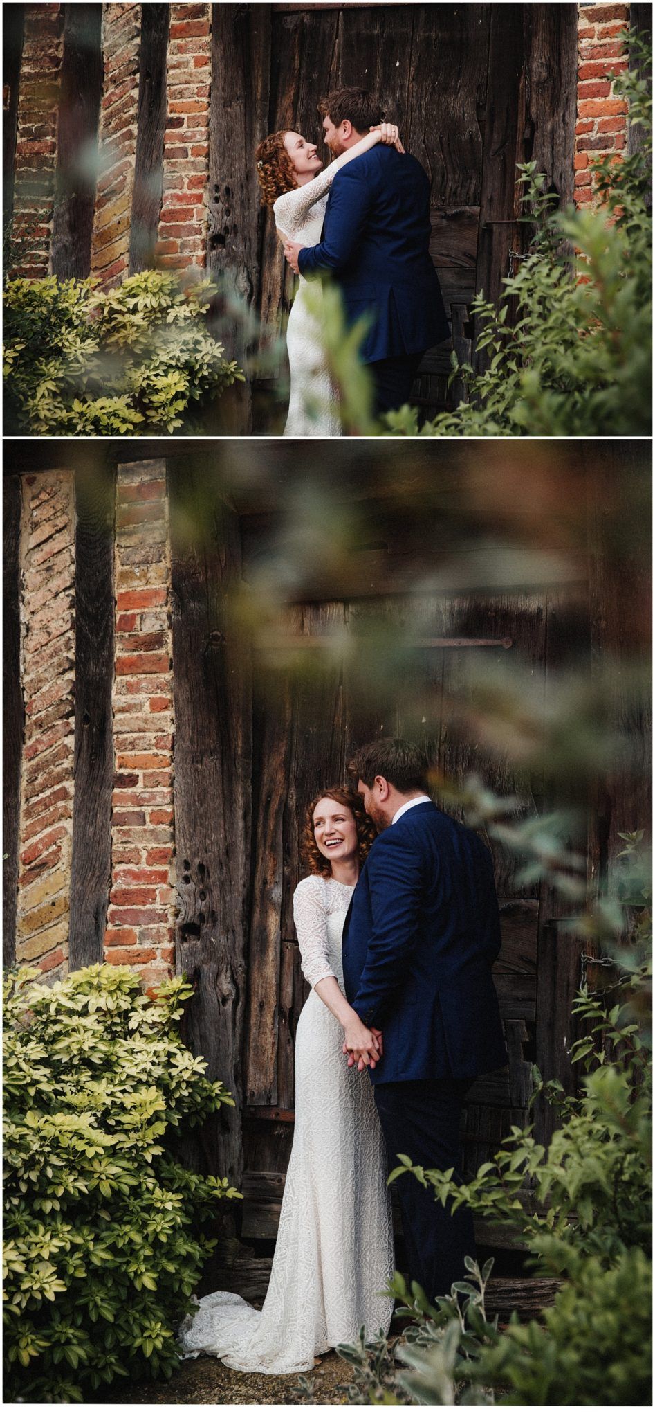 Bride and groom hold each other and laugh by the medieval barn