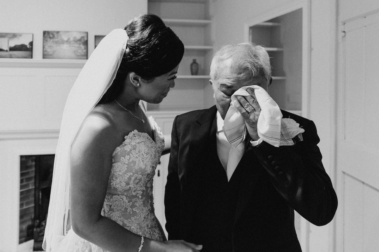 the brides dad is emotional after seeing his daughter in her wedding dress