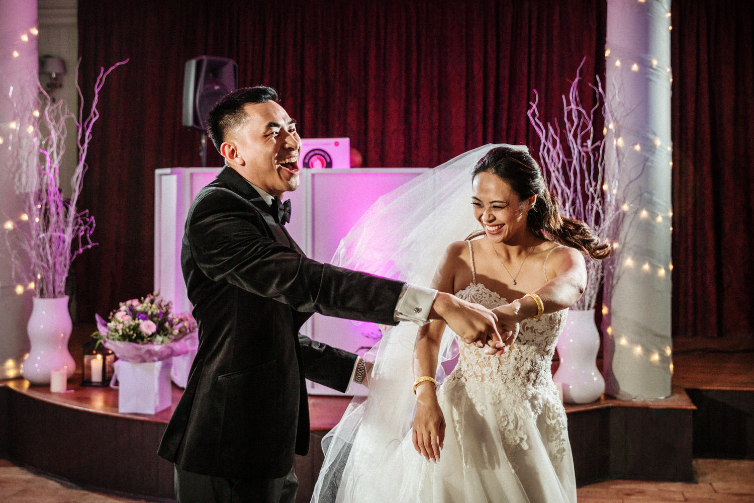 The bride and groom have fun during the first dance