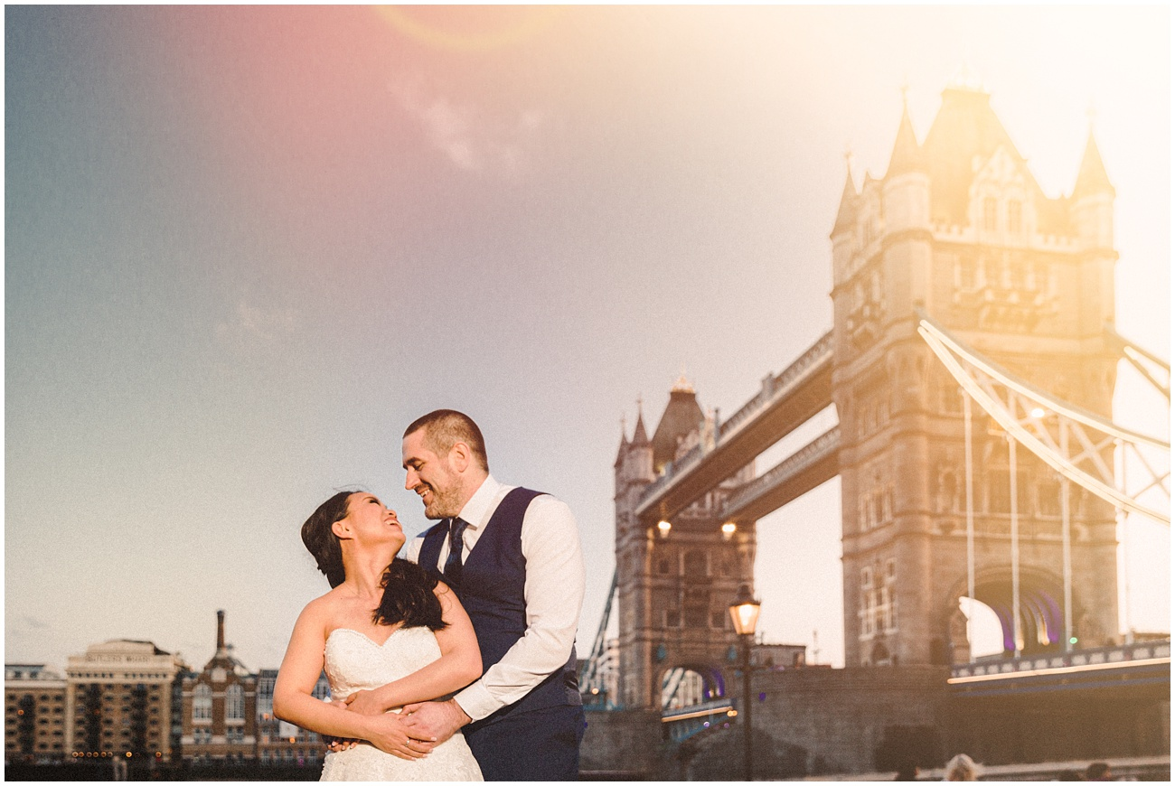 A portrait of the couple during sunset at the Tower Bridge