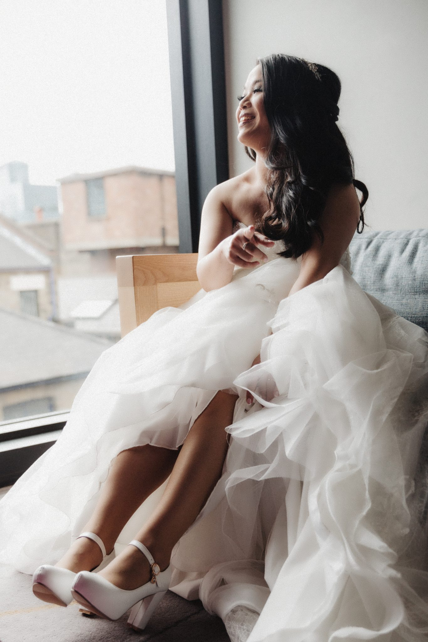 The bride laughing in her white wedding dress