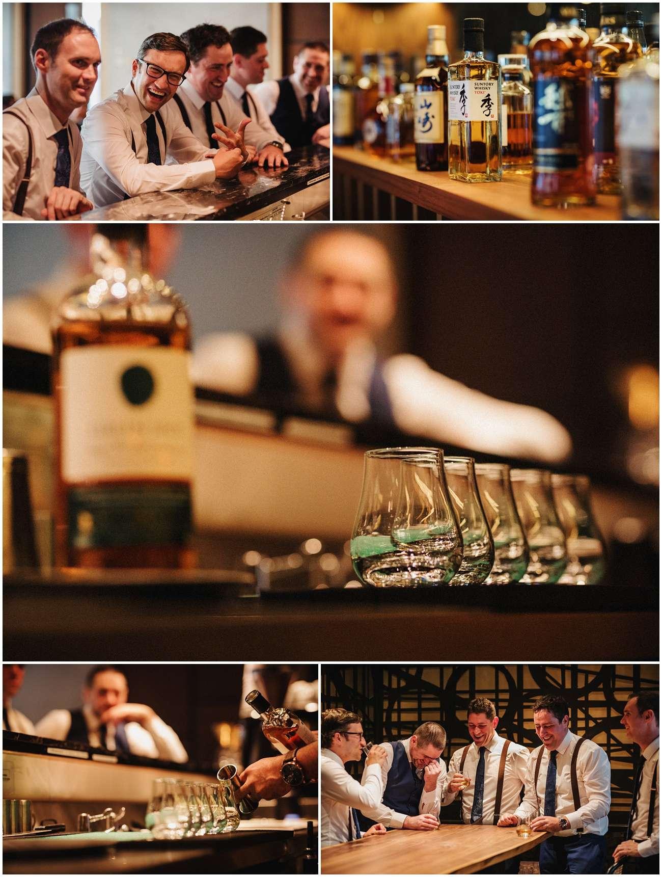 The groomsmen drink whisky at the bar at Nobu Hotel
