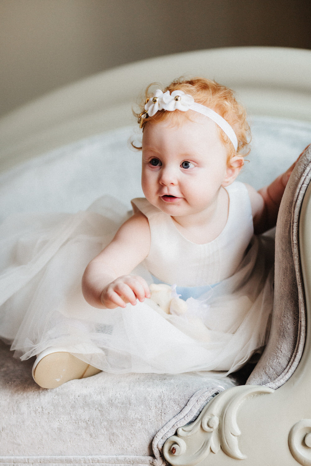 baby flower girl smiling sitting down