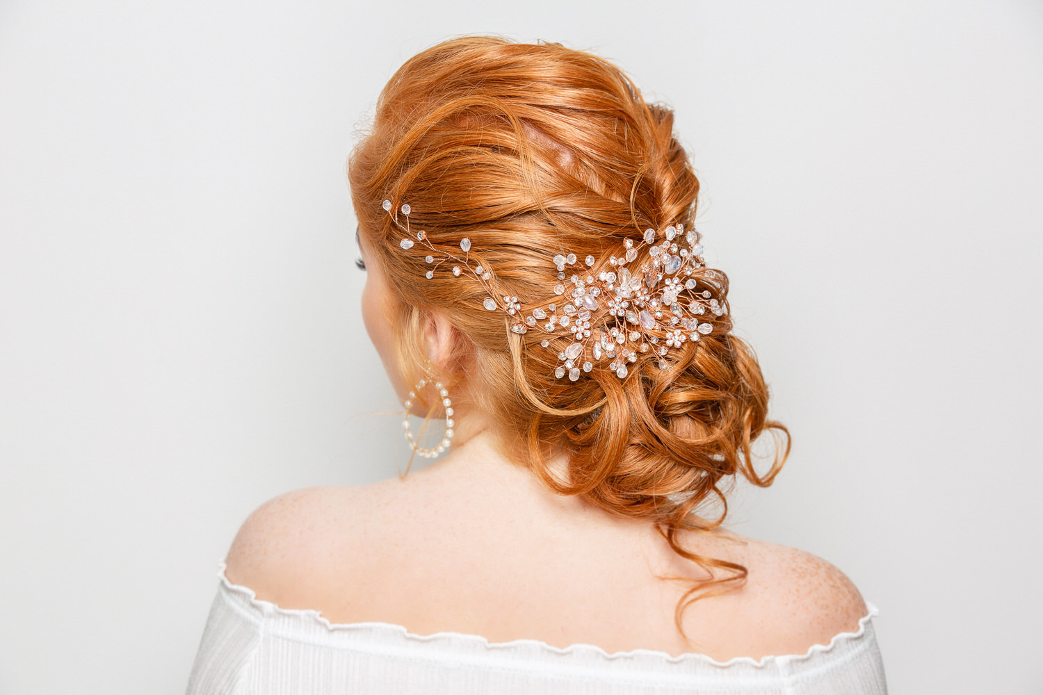 red hair bride back of her head with hair clip in