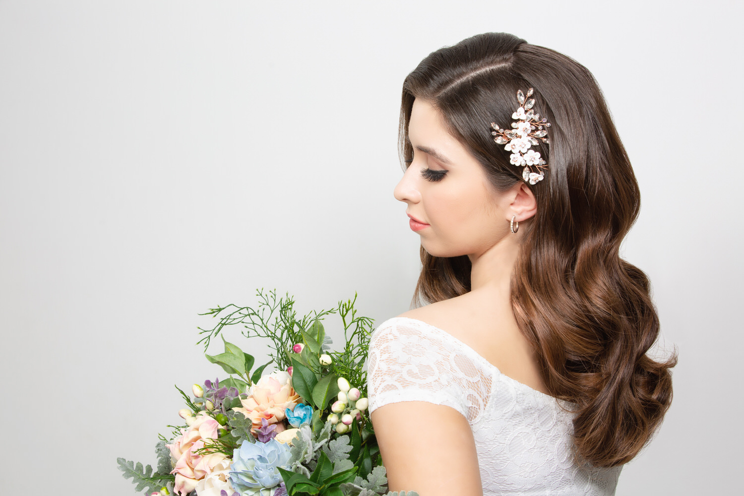 Brunette haired model holding wedding bouquet