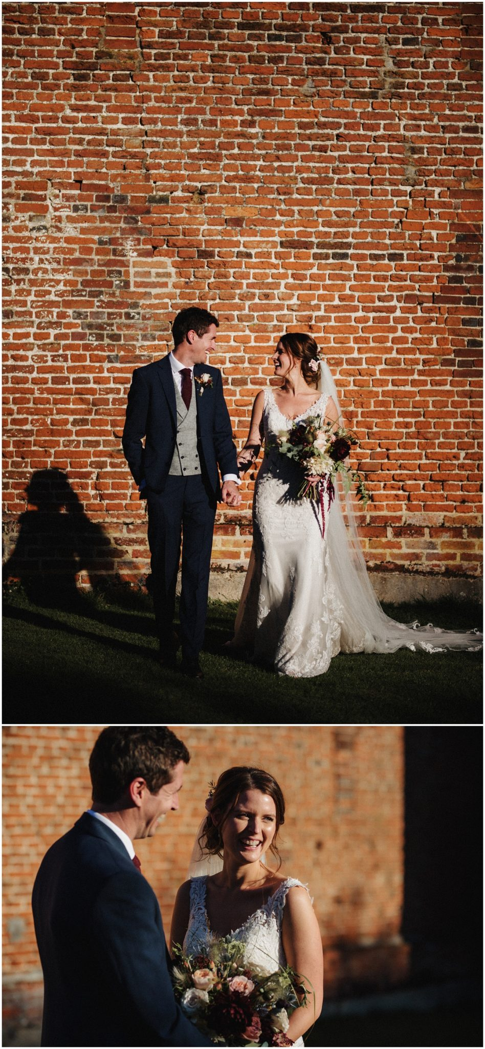 Bride and groom laughing by the red brick barn