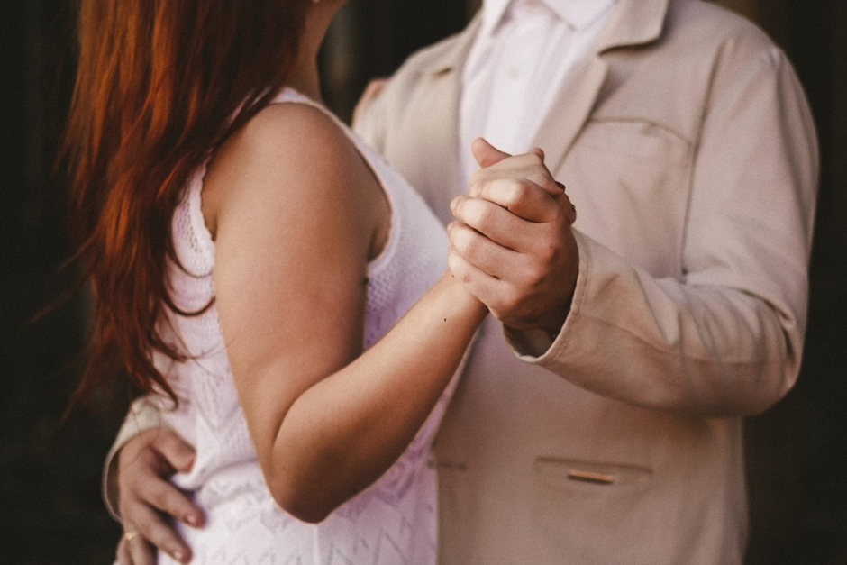 close up of couple practising their first dance holding hands