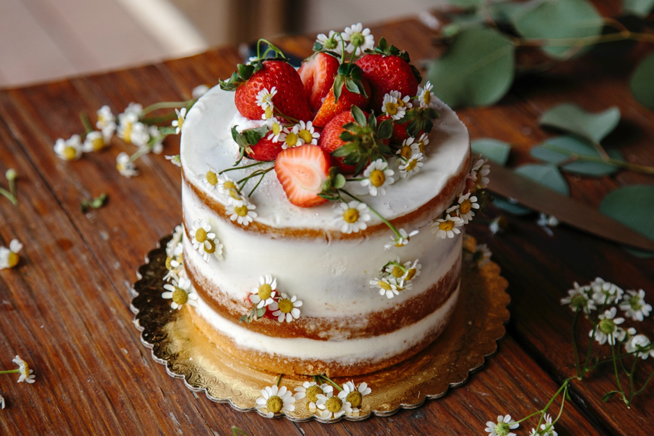 Image of a wedding cake with strawberries on top