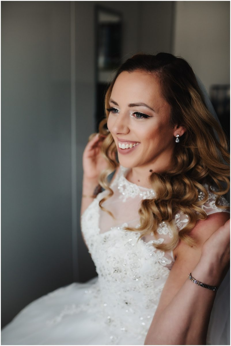 Bride smiling in wedding dress