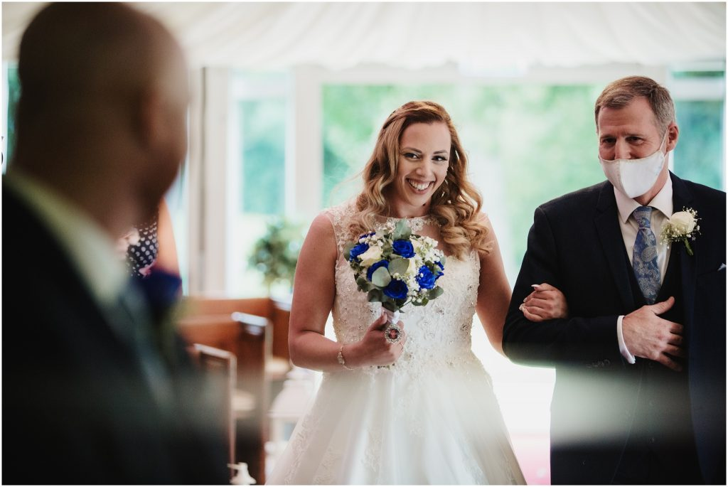 The Rochford Hotel wedding photography - bride walks down the aisle with her uncle