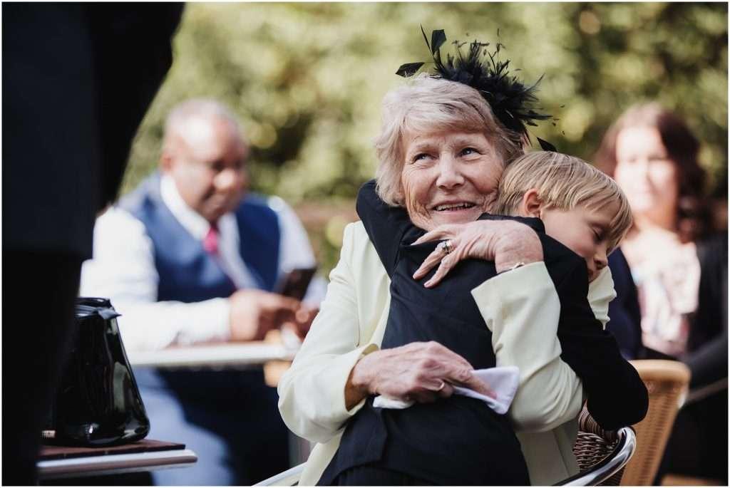 The Rochford Hotel wedding photography - Lady cuddles grandson