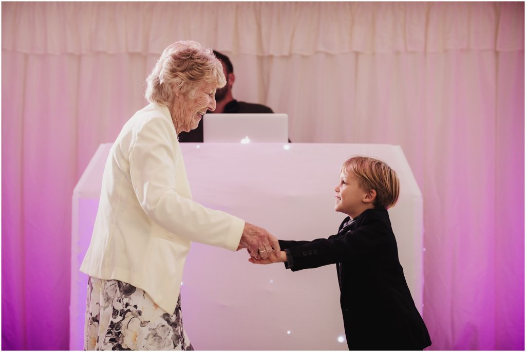 The Rochford Hotel wedding photography - Nan and Grandson dance