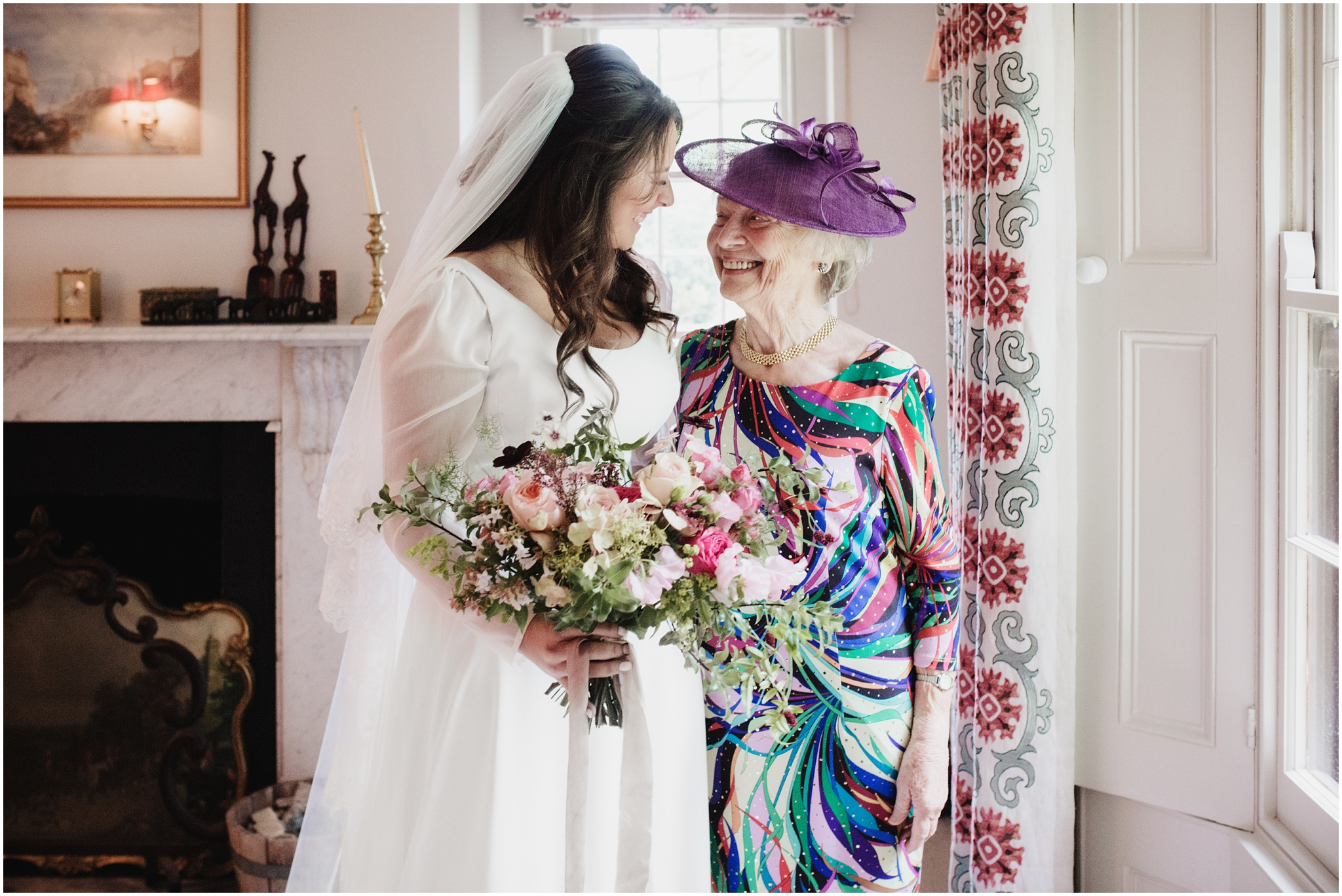 Bride smiles with her nan by the window