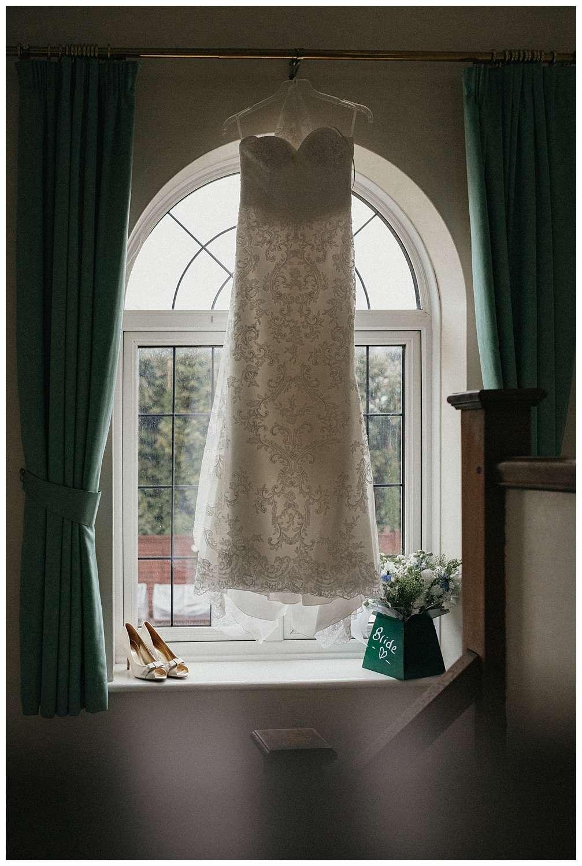 Wedding at Foxhills, Surrey Wedding Photographer - the wedding dress hanging