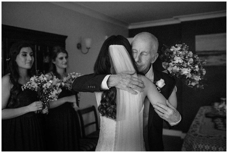 Wedding at Foxhills, Surrey Wedding Photographer - Dad hugs his daughter