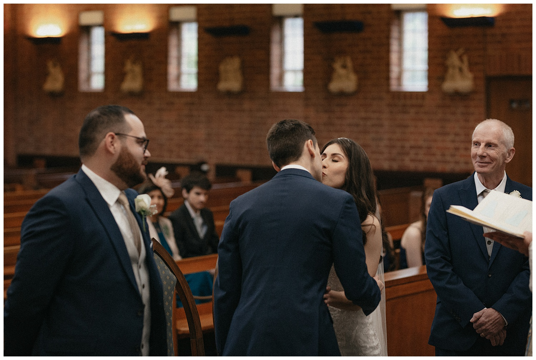 Wedding at Foxhills, Surrey Wedding Photographer - The kiss at the altar