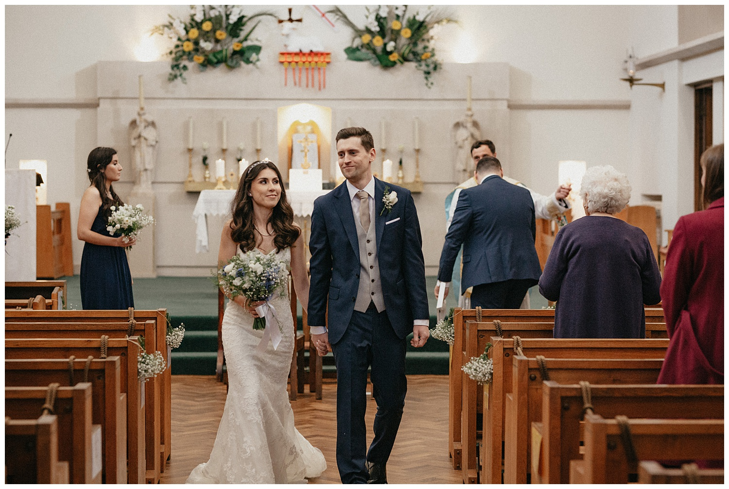 Wedding at Foxhills, Surrey Wedding Photographer - bride and groom walking down the aisle
