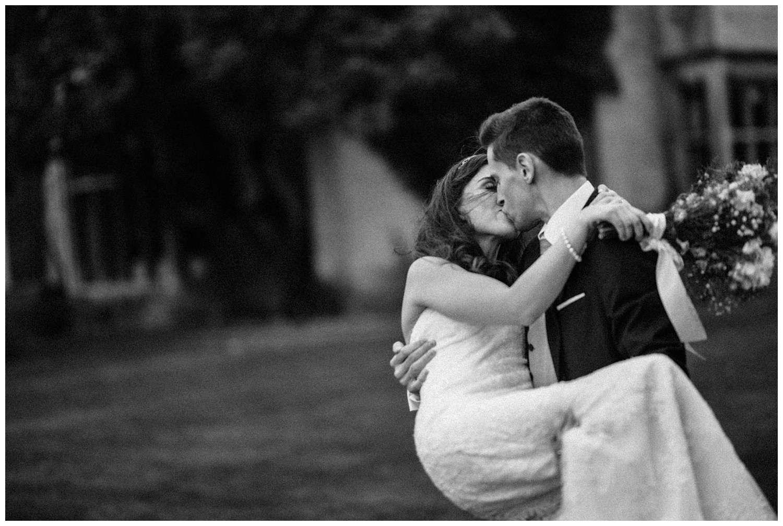Wedding at Foxhills, Surrey Wedding Photographer - groom picks bride up and kiss
